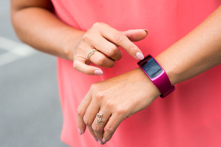 A woman cheking her smartwarch Pink Adult Adults Only Bracelet Close-up Connection Day Device Gadgets Healthy Lifestyle Human Body Part Human Body Parts Human Hand Men One Person Outdoors People Pink Color Smart Watch Sport Time Watch Wearable Computer Woman Hand Wristwatch