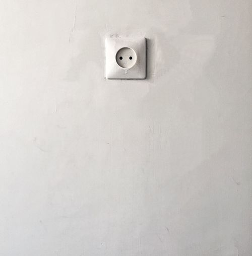 Close-up of outlet on wall