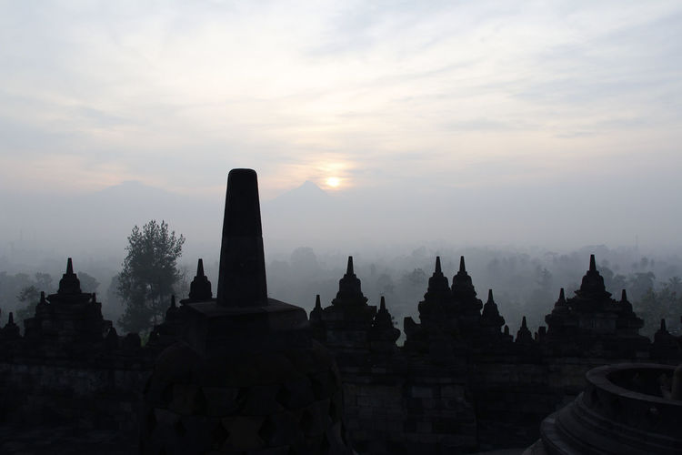Silhouette Borobudur Temple with the mysteries forest surrounding during sunrise, Yogyakarta, Indonesia Ancient Borobudur Temple Java Yogyakarta Ancient Ancient Civilization Architecture Buddhism Built Structure Dawn Fog Forest History Mount Merapi Nature No People Place Of Worship Religion Religious Architecture Sky Spirituality Sunrise Sunset The Past Travel