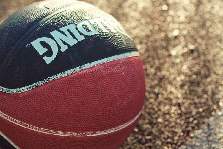 Basketball Basketball Close-up Text Western Script Sport Communication Ball Focus On Foreground Capital Letter American Football - Sport Textile Clothing Textured  Pattern Day Still Life Indoors  American Football - Ball No People Red High Angle View