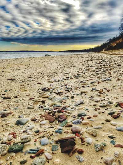 ColorfulRocksAtSunrise-CaumsettStatePark Beach Sea Sand Water Sky Shore Nature Horizon Over Water Beauty In Nature Cloud - Sky Scenics Outdoors No People Tranquil Scene Tranquility Vacations Pebble Beach Day Caumsett State Park Long Island Sound Long Island, Ny Lloyd Harbor