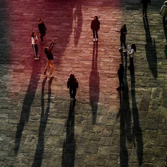 High angle view of people shadow on street playing volleyball