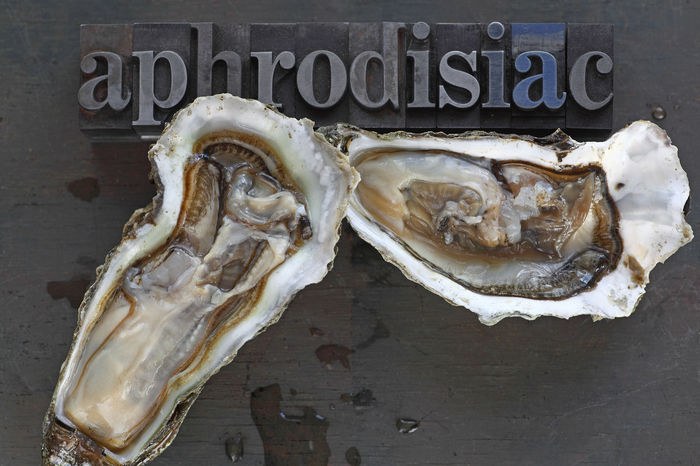 Oysters with aphrodisiac word in old metal type Half Shell Soft Textures Typography Aphrodisiac Bivalves Close-up Dark Background Day Font Food Freshness Healthy Eating Indoors  Metal Type No People Overhead Oysters Seafood Shellfish Photography Studio Shot Tasty Text Typeface  Wet