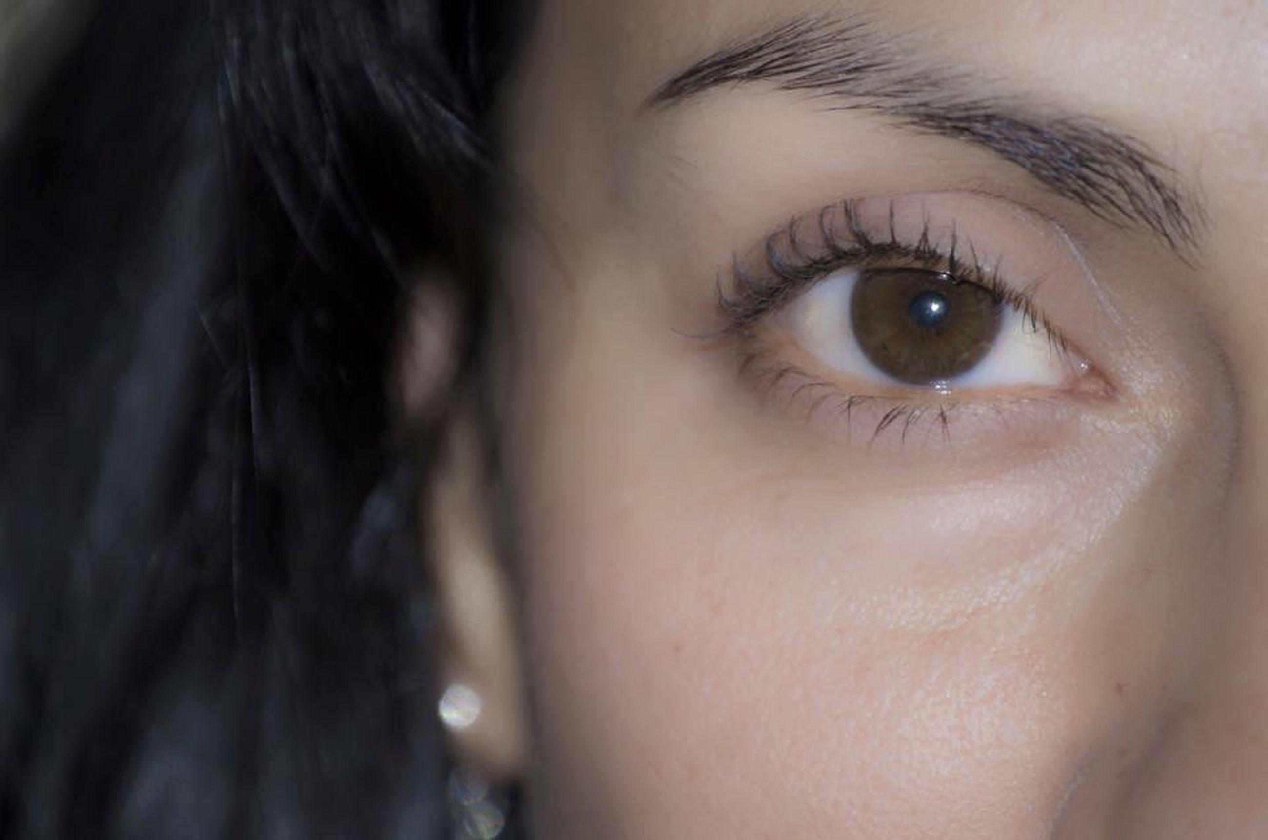 close-up, human eye, headshot, human face, looking at camera, lifestyles, portrait, eyelash, young adult, person, indoors, young women, part of, human skin, eyesight