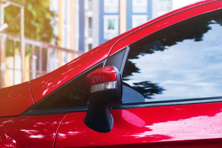 Close-up of red car on window