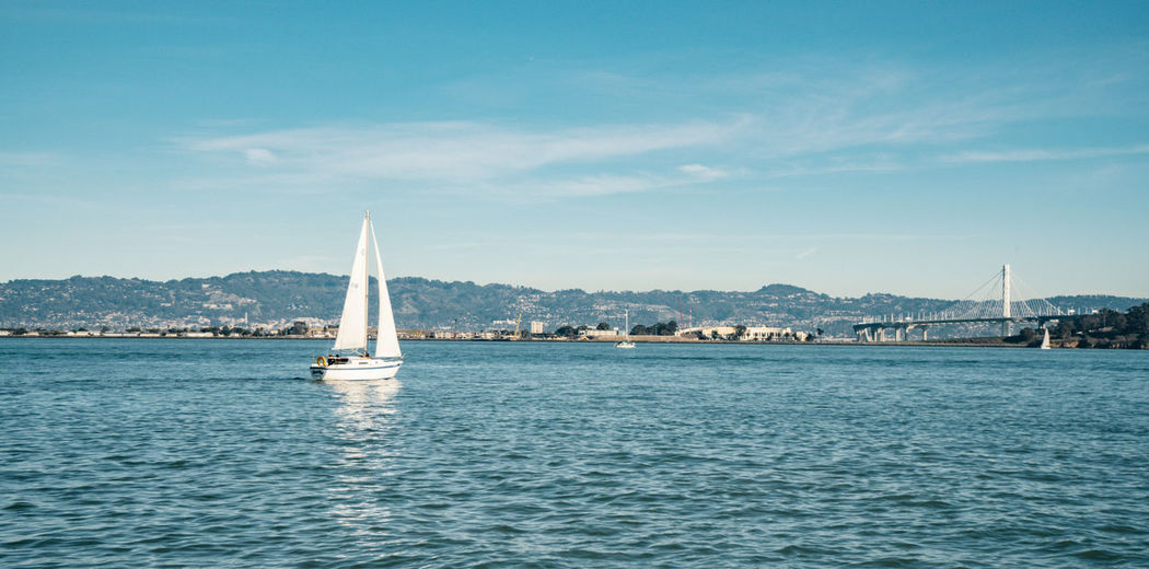 Water Nautical Vessel Transportation Sea Sailboat Mode Of Transportation Sky Waterfront Travel Sailing Nature Day Beauty In Nature No People Mountain Canvas Scenics - Nature Architecture Blue Outdoors Yacht Bay Luxury Yachting