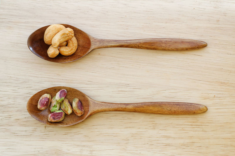 Cashew and pistachio nuts Food Wooden Background Wooden Spoon Diet Healthy Eating Healthy Snacking Weight Loss Food Pistachio Nuts Cashew Raw Organic Snack Studio Shot Close-up
