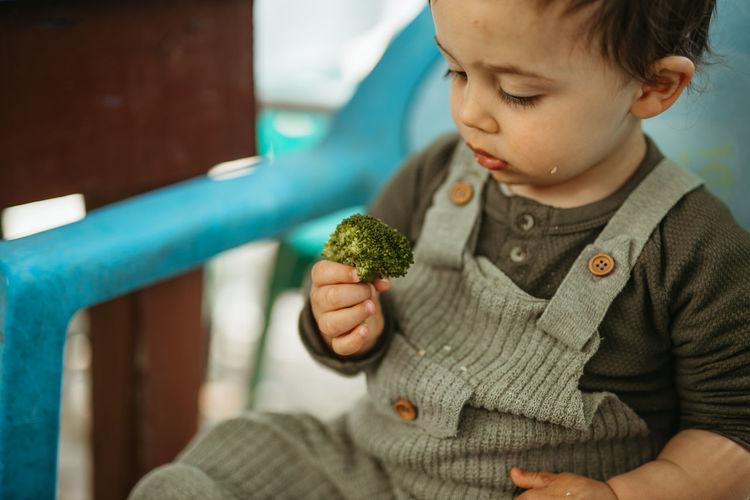 Cute boy holding food