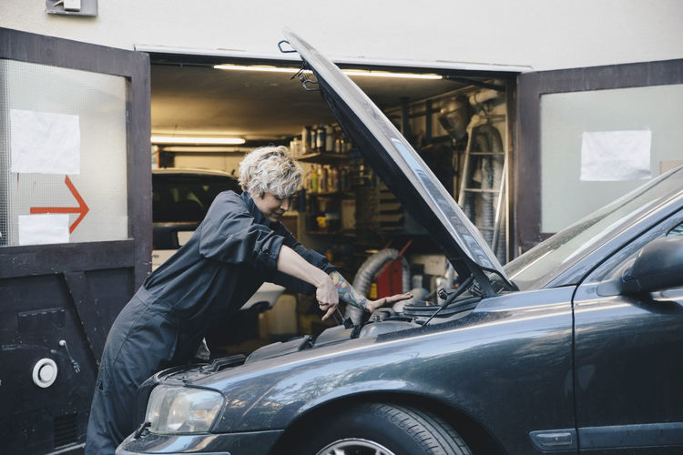 Man working in car