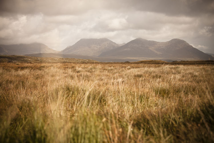 Scenic view of connemara mountains against sky