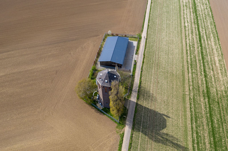 areal view of rural village Nature Day Outdoors High Angle View Structure And Nature Architecture Houses Land Road No People Buliding Tree Agriculture Field Rural Scene