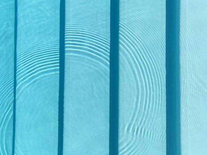 Dots and Loops Leisure Activity Vacations Summer Swimming Pool Steps Full Frame Pattern Backgrounds Close-up Textured  No People Textile Blue Day Striped Abstract