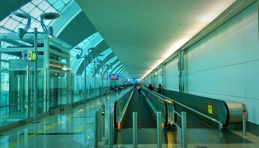 People using escalator at airport