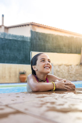 Portrait of a smiling young woman in swimming pool