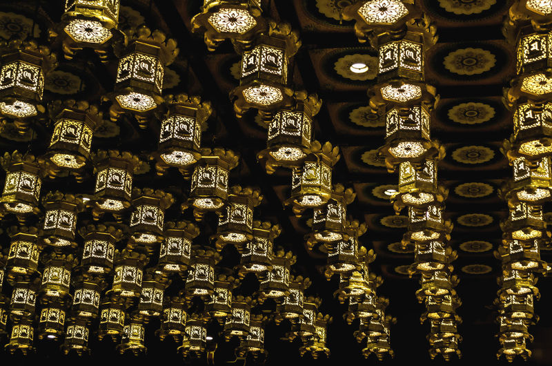 Low angle view of lanterns on ceiling
