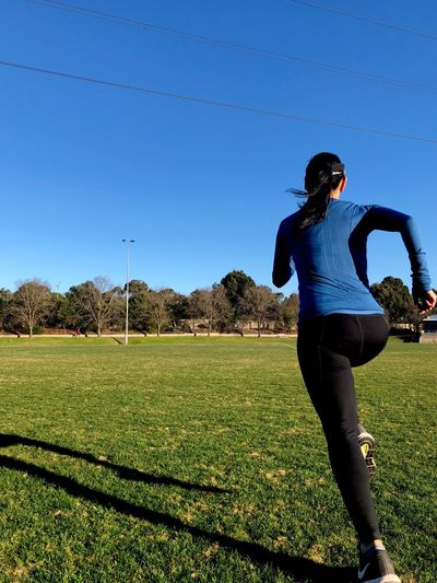 Woman running Sprinting Running Fitness Training Wellbeing Healthy Activewear Fitness Training Outdoor Sports Run In Action Runner Running Girl Woman Running Exercise Fit Woman Active Active Lifestyle  One Person Lifestyles Leisure Activity Sky Full Length Field Rear View Grass Clear Sky