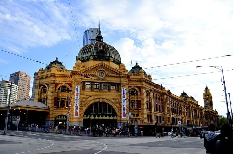 Flinders Street railway station is a railway station on the corner of Flinders and Swanston Streets in Melbourne, Australia. Dome Architecture Travel Destinations Built Structure Sky Cloud - Sky Building Exterior City Train Station Melbourne City Melbournecbd Train Stations Train Station Architecture Australia Flinders Street Station EyeEmNewHere