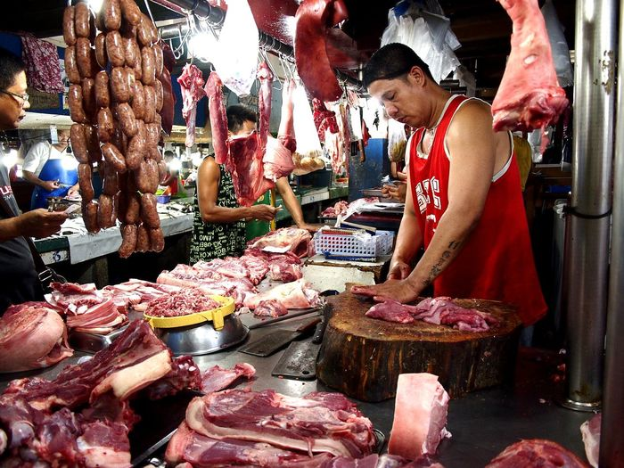 meat vendor at a market Beef Pork ASIA Asian  Philippines Filipino Man Males  Butcher Meat Butcher Meat! Meat! Meat! Meat Shop Market Fresh Raw Raw Food Fresh Meat Market Retail  Butcher For Sale Small Business Men Food And Drink Market Stall Market Vendor Vendor Stall Farmer Market Shop
