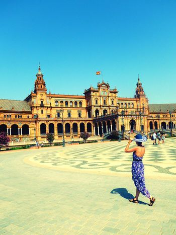 Architecture Built Structure Building Exterior Clear Sky Full Length Sunlight Leisure Activity Women Who Inspire You Travel Destinations History City Day Blue In Front Of Tourism Outdoors Famous Place Casual Clothing Façade Town Square SPAIN Sevilla Spain New Talent People And Places Andalucía Andalusia