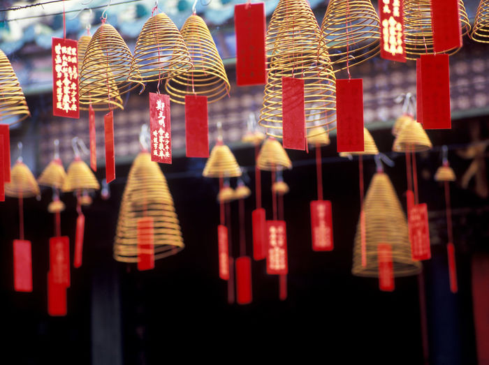 Low angle view of spiral incenses at temple