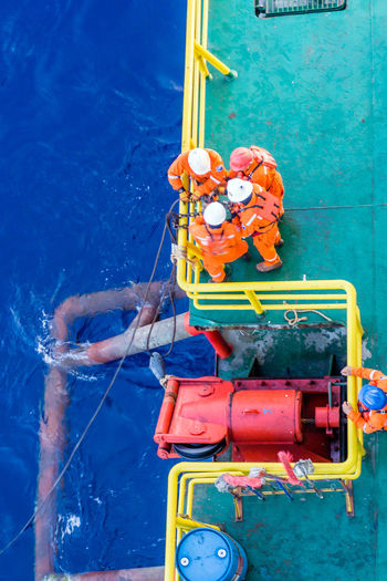 Offshore worker or rigger performing anchor handling task Construction Edge Industry Offshore Rigger Rope Teamwork Worker Able Bodied Anchor Handling Coverall Coveralls Deck Enjoying Life Fairlead Handrail  Hardhat  Installation Offshore Life Oil And Gas Safety Seaman Wire ındustry