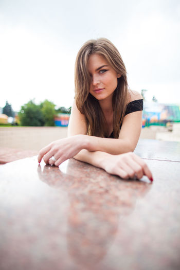 Close-up of beautiful woman against sky