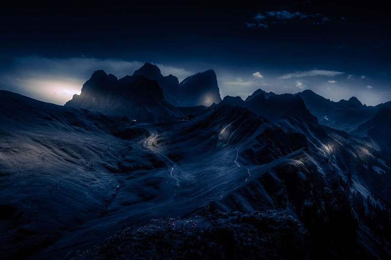 Scenic night view of snowcapped mountains against sky