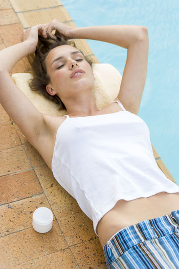 High Angle View Of Woman Lying At Poolside