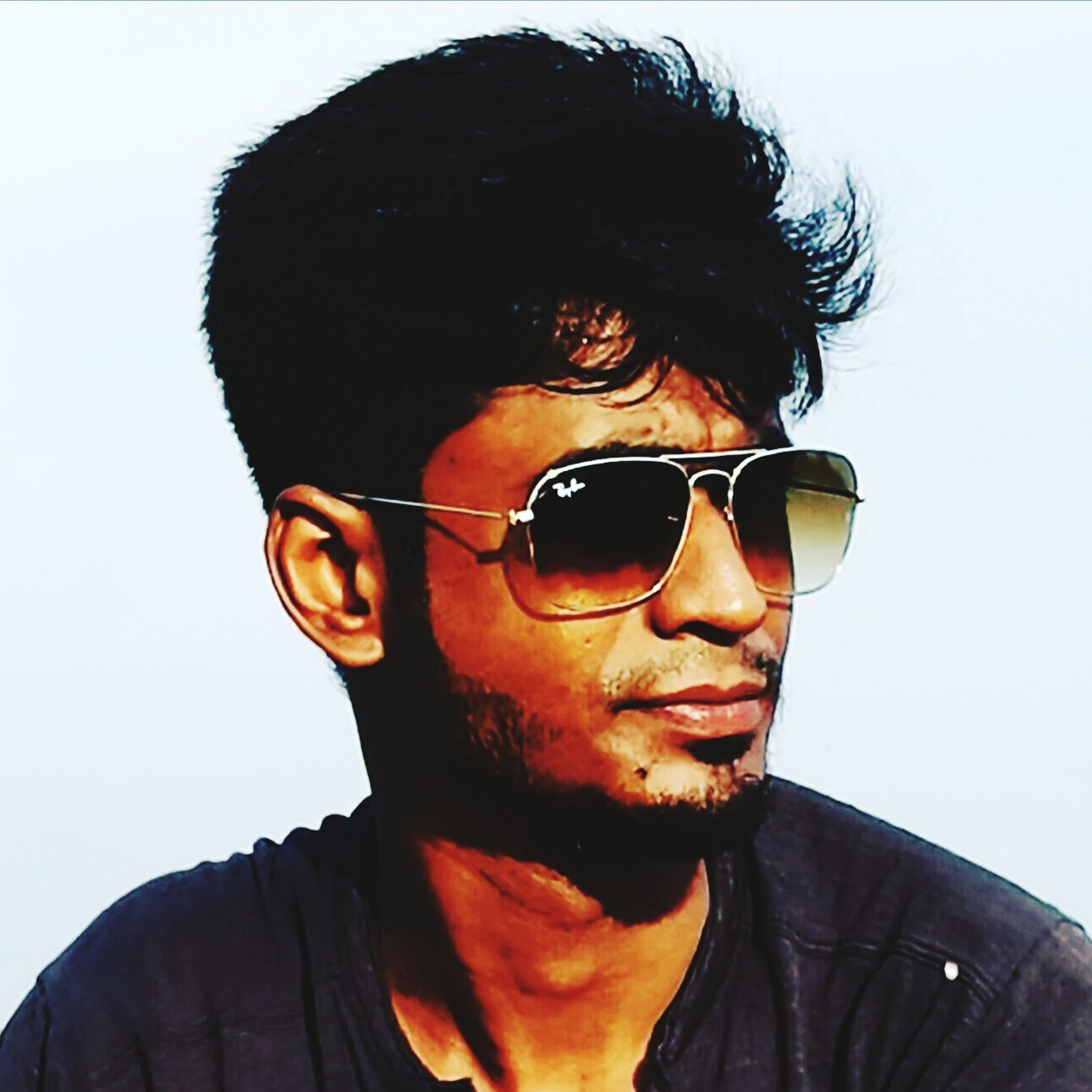 sunglasses, real people, one person, young adult, mid adult, front view, looking at camera, lifestyles, portrait, mid adult men, head and shoulders, black hair, young men, leisure activity, headshot, outdoors, day, sky, clear sky, smiling, young women, close-up