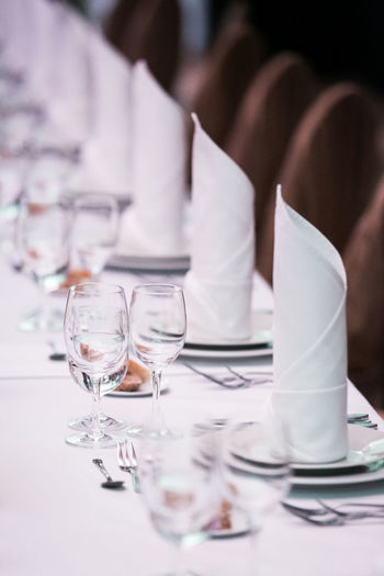 Event GalaDinner Napkins Wedding Crockery Dining Dining Table Drinking Glass Eating Utensil Fancy Dinner Food And Drink Gala Dinner Glass Indoors  Luxury Napkin No People Party - Social Event Place Setting Plate Preparation  Restaurant Setting Table Wineglass