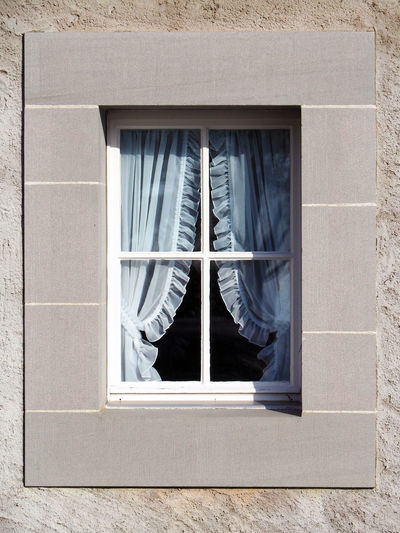 Curtain On Window Of House