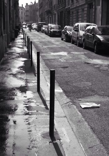 Left behind Streetphotography Journal Newspaper Trottoir Coulees Water Reflections Lost
