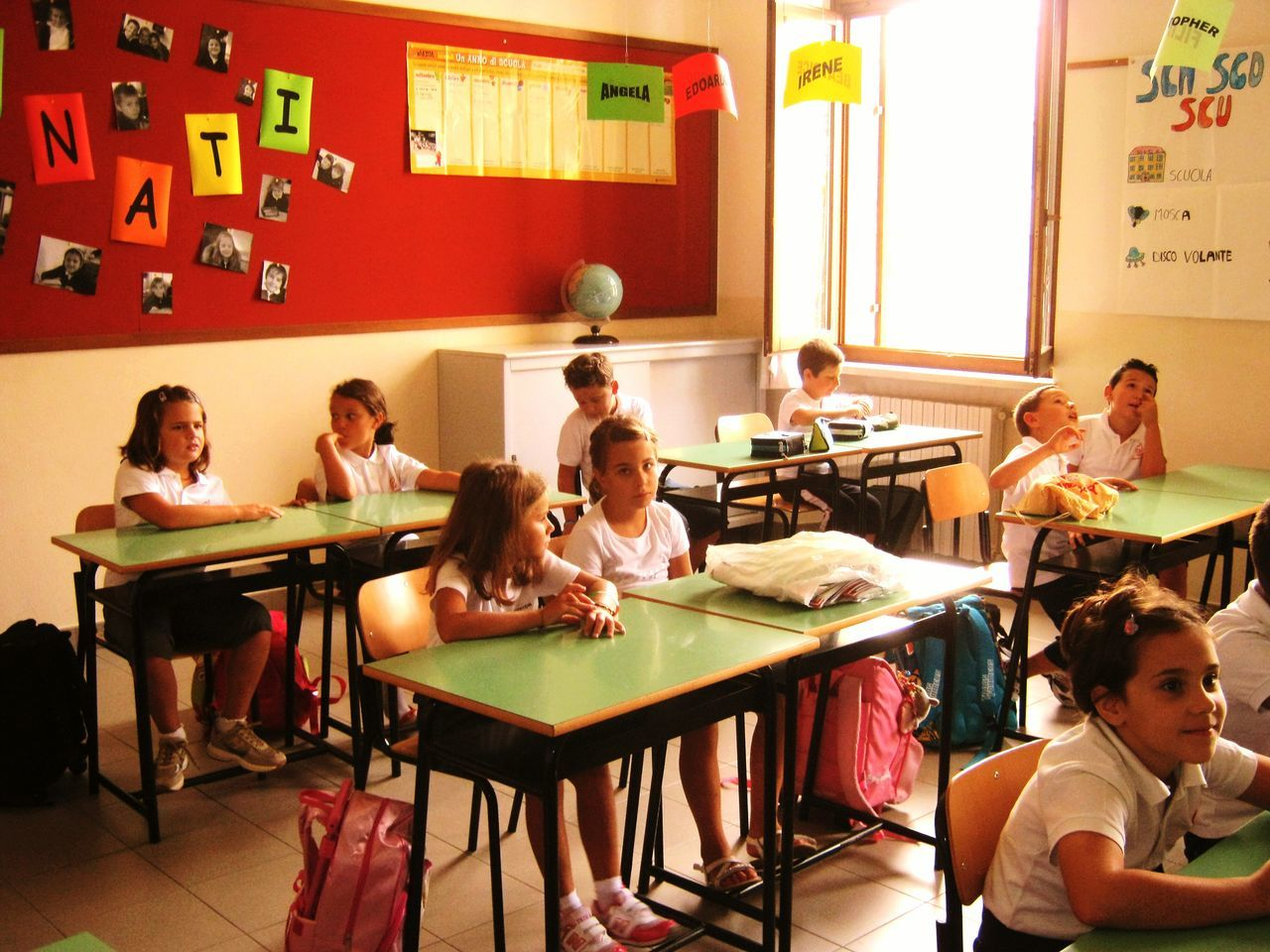 education, desk, indoors, classroom, table, sitting, large group of people, girls, group of people, boys, real people, learning, student, childhood, day, people