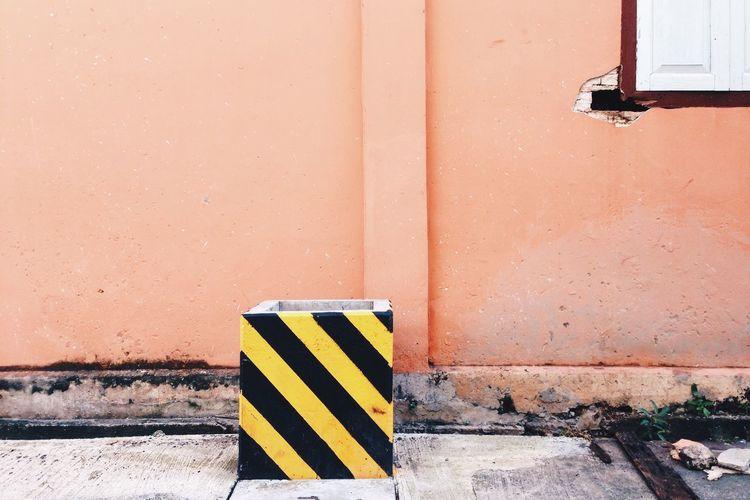 Hazard sign on wall
