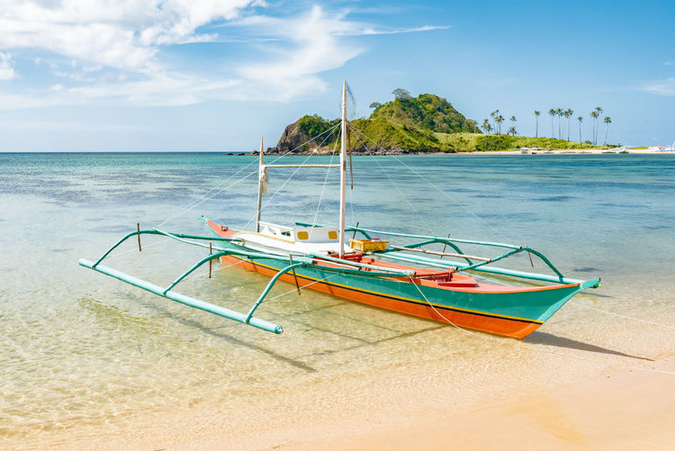 Beach Blue Cloud - Sky Day Horizon Over Water Nature Nautical Vessel No People Outdoors Outrigger Palm Tree Sand Sea Sky Sunlight Sunny Tranquil Scene Tranquility Travel Destinations Vacations Water