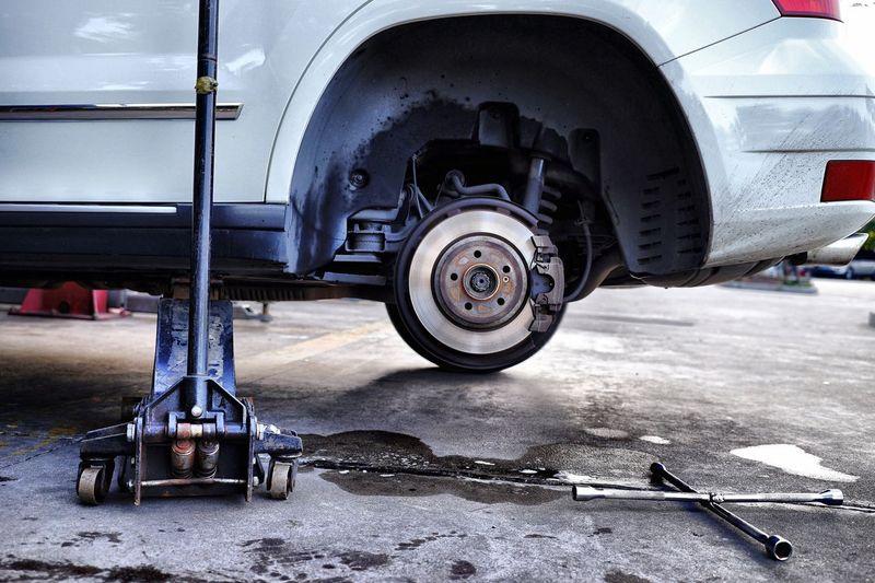 Close-up of car brake disc at garage