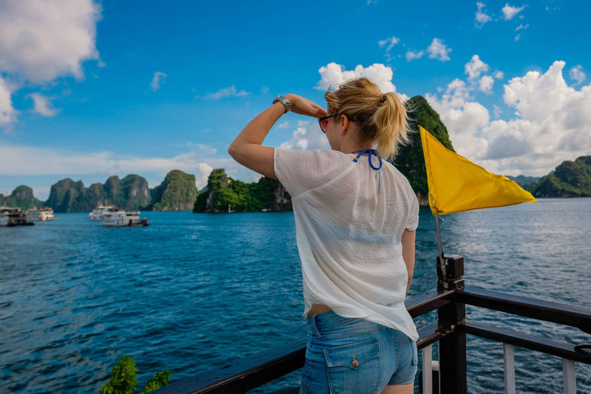 Floating along in Halong Bay Woman Adult Blond Hair Casual Clothing Cloud - Sky Day Hair Hairstyle Leisure Activity Lifestyles Looking Away From Camera Nature One Person Outdoors Railing Real People Rear View Sky Standing Water Women