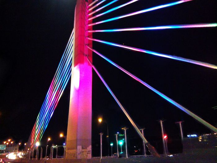 Paso Nightlife City Life City Night Architecture Low Angle View Illuminatedpati Bridge Laser Pink Color Neon Multi Colored Built Structure Sky Social Issues Outdoors Neon Colored Event People Midnight First Eyeem Photo