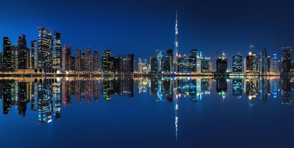 Dubai skyline Dubai Lights Reflection UAE Architecture Blue Building Exterior Built Structure Business Bay City Cityscape Clear Sky Illuminated Modern Night No People Outdoors Reflection Sky Skyscraper Symmetry Travel Destinations Urban Skyline Water Waterfront