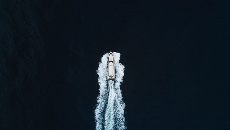High Angle View Of Boat Moving On Sea