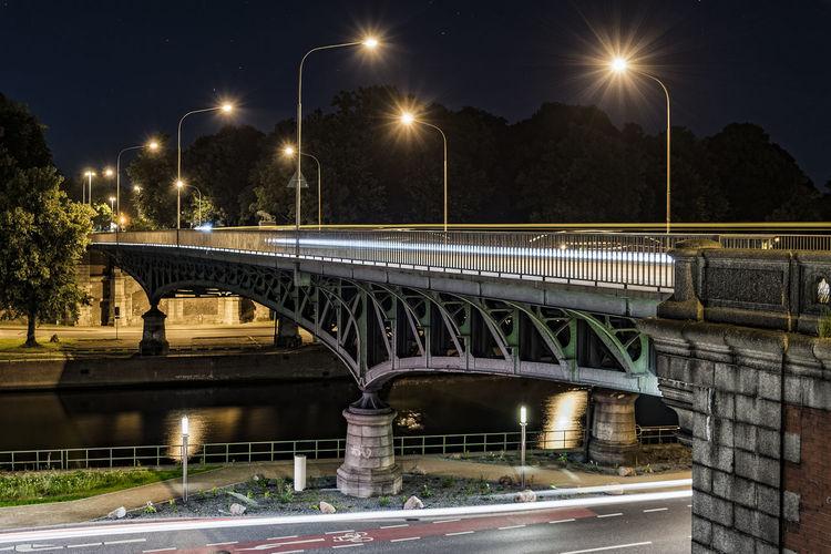 ILLUMINATED OLD BRIDGE BY NIGHT
