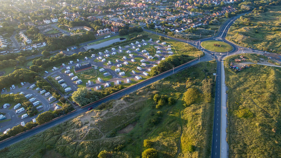 Early morning over Southport Caravan Club site Aerial Photography Aerial View Air Vehicle Beauty In Nature Caravan Park City Coastal Location Connection Day Drone Photography Early Morning Light Flying Green Journey Nature Outdoors Regimented Roundabout Rural Scene Sanddunes Scenics Southport Tranquil Scene Tranquility