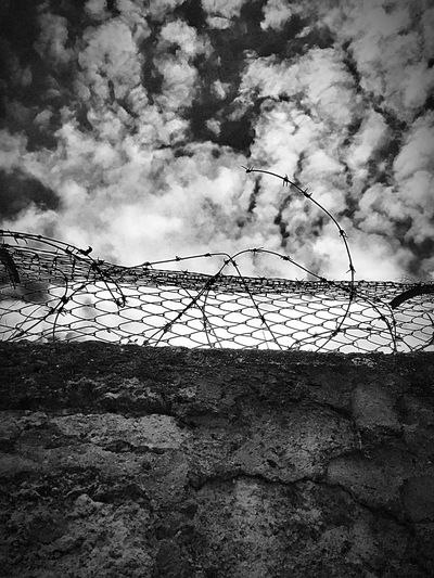 Beyond the wall Cloud - Sky Barbed Wire Hope Barbed Wire Against The Sky Barbed Wire Photography EyeEmNewHere Blackandwhite