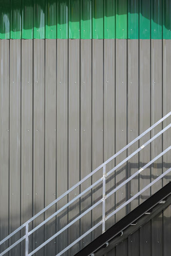 Low angle view of railing against wall