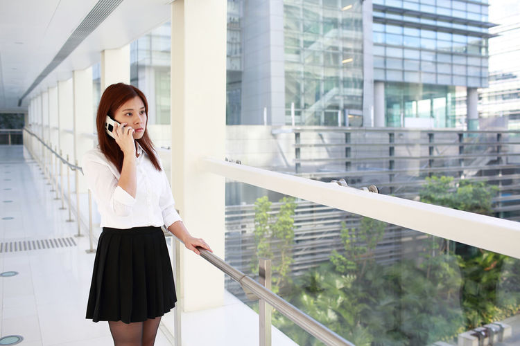 Futuristic Office Portrait Of A Woman Women Who Inspire You Worker Working Business Finance And Industry Career Communication Girl Girls Job Mobile Phone Model Occupation Portrait Pose Smart Phone Technology Telephone Using Phone White Wireless Technology Woman Portrait Young Adult