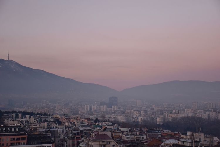 view over Sofia in the morning light Building Exterior Architecture Built Structure City Sky Mountain Cityscape Residential District Building Crowd Nature Sunset Crowded Mountain Range High Angle View Outdoors Beauty In Nature Dusk Community TOWNSCAPE Romantic Sky