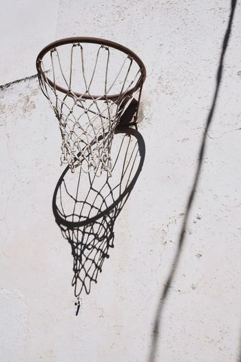 Low angle view of basketball hoop against wall