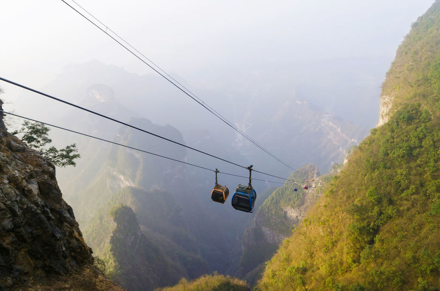 The longest cable car in the world, Tianmen Shan, Zhangjiajie China. Hunan Province, China Tianmen Mountain Travel Beauty In Nature Cable Cable Car Day Fog Longest Mode Of Transportation Mountain Mountain Range Nature No People Non-urban Scene Outdoors Overhead Cable Car Plant Scenics - Nature Ski Lift Sky Tranquil Scene Transportation Travel Tree