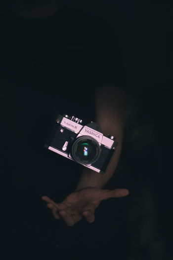 Black Background Camera - Photographic Equipment Holding Human Body Part Human Hand One Person Photographer Photographing Photography Themes Photoshop Studio Shot Technology