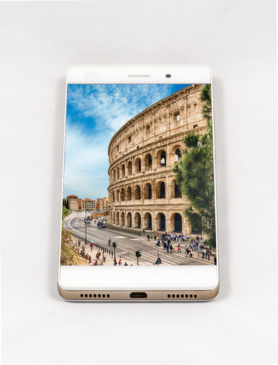 Modern smartphone with full screen picture of Rome, Italy. Concept for travel smartphone photography. All images in this composition are made by me and separately available on my portfolio Arch Architecture Building Building Exterior Built Structure City Cloud - Sky Day Glass - Material Group Of People History Incidental People Nature Outdoors Sky The Past Tourism Travel Travel Destinations Window